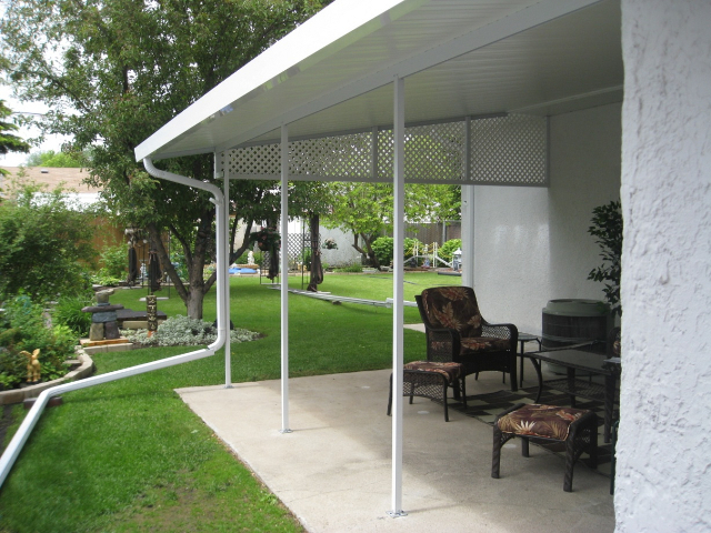 Patio covers car ports glastar sunrooms by sunshade for Car patio covers
